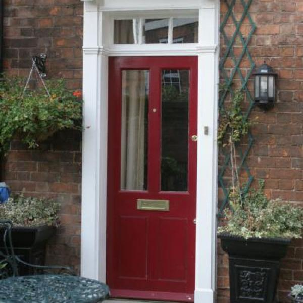 Red door with white surround